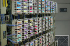 Colorful telecom switch. Orderly racks of telephone wire in a data center Stock Photography