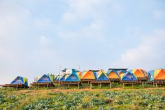 Colorful tent on the hill. Under blue sky Royalty Free Stock Photo