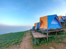 Colorful tent on the hill. Under blue sky Stock Photo