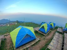Colorful tent on the hill. Under blue sky Stock Image