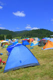 Colorful tents mountain camping site Stock Photos