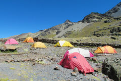 Colorful tents stanging in high mountain camping Stock Image