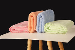Colorful terry towels isolated on dark background Royalty Free Stock Photography