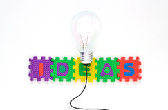 Colorful text ideas and Bulb light, business concept jigsaw puzzle Stock Photography