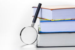 Colorful textbooks and Magnifying Glass Royalty Free Stock Images