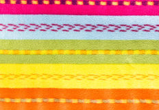 Colorful textile background texture. Fabric multicolor back. Stock Photos
