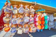 The colorful textile dolls for kitchen, Marsaxlokk market stock photography