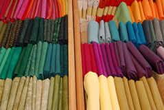 Colorful textile fabrics in small bundles. Textile cloth sheets ordered by colors and in small bundles for patchwork quilting Royalty Free Stock Photography