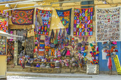 Colorful textile for sale in Peru. Display of colorful textile and clothes at a shop in the Andes in Peru stock photography