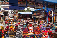 Colorful textile stall with hats in the popular Royalty Free Stock Image