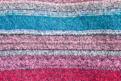 Colorful textile. A colorful striped wool textile as a background Stock Image