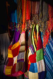 Colorful textiles. Rows of colorful textiles on display in shop Stock Photography