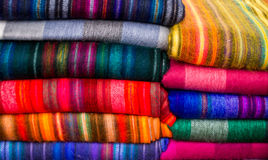 Colorful textiles in many colors. Beautiful multi-colored textiles in all colors of the rainbow - Otavalo, ECUADOR in November 2015 Stock Photos