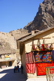 Colorful textiles on stucco wall,. Ollantaytambo,  Peru, South America Royalty Free Stock Image