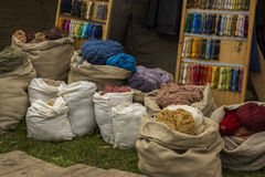 Colorful textiles workshop. Colorful textiles in sacks, tailor workshop Stock Photo