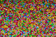 Colorful texture with candies. Colorful background with blue, pink, red, orange, green and yellow candies Stock Photos