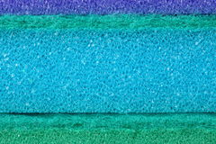 Colorful texture cellulose foam sponge background. Blue green texture cellulose foam sponge background royalty free stock images