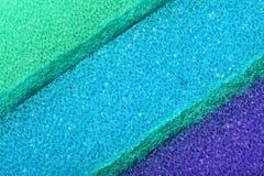 Colorful texture cellulose foam sponge background. Blue green texture cellulose foam sponge background stock images