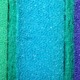 Colorful texture cellulose foam sponge background. Blue green texture cellulose foam sponge background. Square format royalty free stock photography