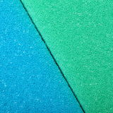 Colorful texture cellulose foam sponge background. Blue green texture cellulose foam sponge background. Square format royalty free stock images