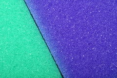 Colorful texture cellulose foam sponge background. Violet green texture cellulose foam sponge background royalty free stock photography