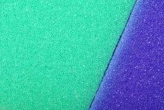 Colorful texture cellulose foam sponge background. Violet green texture cellulose foam sponge background stock photo
