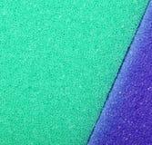 Colorful texture cellulose foam sponge background. Violet green texture cellulose foam sponge background. Square format stock photo