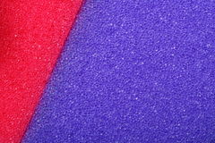Colorful texture cellulose foam sponge background. Violet red texture cellulose foam sponge background stock photos