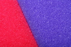 Colorful texture cellulose foam sponge background. Violet red texture cellulose foam sponge background royalty free stock image