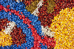 Colorful texture of chemically treated corn maize crop seed. Ready for seeding Stock Images
