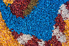 Colorful texture of chemically treated corn maize crop seed. Ready for seeding Royalty Free Stock Photo