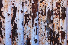 Colorful texture of old paint on rusty metal door. Colorful texture of old paint on rusty metal door stock photography