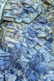 Colorful texture of volcanic rock in the Background. Blue vein magma tic quartz rock close up stock photo