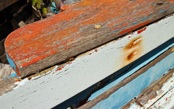 Colorful texture of Weathered Wooden Fishing Boat Rail with Rust Stains from Nail Holes Royalty Free Stock Photos