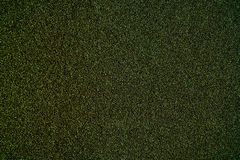 Colorful textured background - Sandpaper texture for Backdrop. A. Bstract rough sandpaper sheet close up, green color Stock Photography