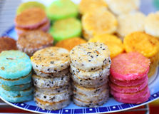 Colorful thai dessert (Kanom Babin). Made of sliced coconut, arrowroot starch and glutinous rice flour Stock Photos
