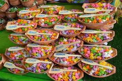 Colorful Thai desserts are packed in small boats royalty free stock photography