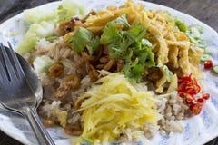 Colorful Thai food named Kao Kluk Ka Pi.  Stock Photos