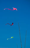 Colorful Thai kites in clear blue sky, Thailand Royalty Free Stock Photos