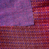 Colorful thai peruvian style rug surface close up. More of this motif & more textiles in my port tatter Old rag Royalty Free Stock Photos