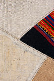 Colorful thai peruvian style rug surface close up. More of this motif & more textiles in my port tatter Old rag Royalty Free Stock Photography