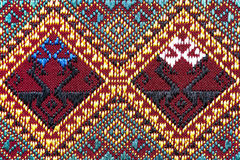 Colorful thai silk handcraft peruvian style rug surface close up Royalty Free Stock Image