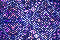 Colorful thai silk handcraft peruvian style rug surface close up More this motif & more textiles peruvian stripe beautiful backgro. Und tapestry persian nomad Royalty Free Stock Photos