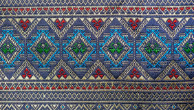 Colorful thai silk handcraft peruvian style rug surface close up More this motif & more textiles peruvian stripe beautiful backgro. Und tapestry persian nomad Royalty Free Stock Photo