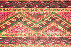 Colorful thai silk handcraft peruvian style rug surface close up More this motif & more textiles peruvian stripe beautiful backgro Royalty Free Stock Photos