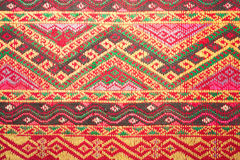 Colorful thai silk handcraft peruvian style rug surface close up More this motif & more textiles peruvian stripe beautiful backgro. Und tapestry persian nomad Royalty Free Stock Image
