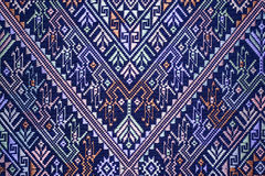 Colorful thai silk handcraft peruvian style rug surface old vintage torn conservation Made from natural materials Chemical free cl. Ose up silk background silk Royalty Free Stock Photo