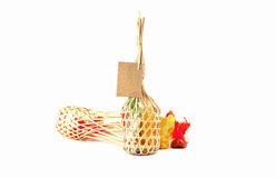 Colorful thai sweets in Wicker round bamboo basket on white back Royalty Free Stock Image