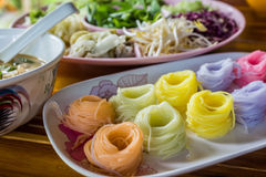 Colorful of Thai vermicelli, rice noodles eaten with curry. Stock Images
