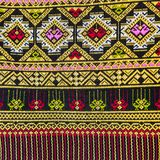 Colorful Thailand style rug surface close up. Royalty Free Stock Image